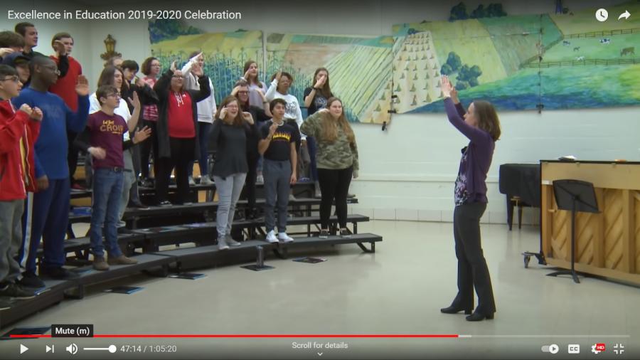 Ms. Gresko conducts.