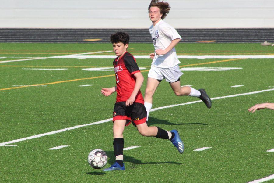 Freshman Charlie Cloyd bringing the ball down the field.