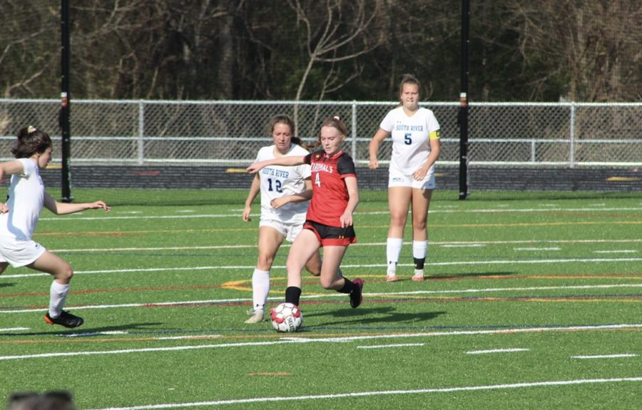 Sophomore Meghan Piazza protecting the ball from South River's defense.